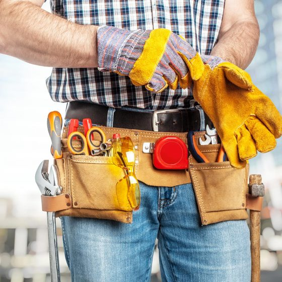 detail of handyman wearing protection gloves